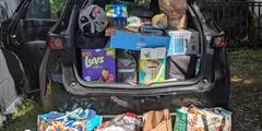 An SUV full of donated supplies