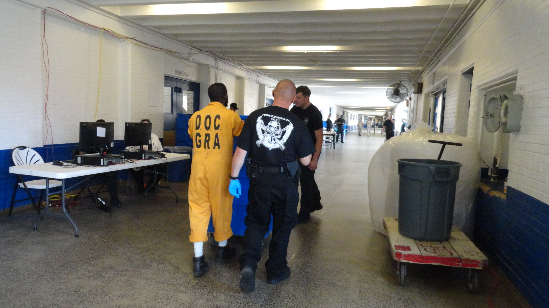 Inmate and property moving through stations.JPG